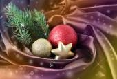 Beautiful Christmas decor on satin cloth — Stock Photo