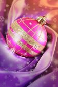 Beautiful Christmas ball on satin cloth, close-up — Stock Photo