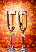 Glasses of champagne on bright background — Stock Photo