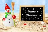 Christmas snowman on beach with photoframe. Christmas and New Year card — Stock Photo