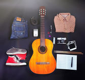 Music equipment, clothes and footwear on black background — Stock Photo