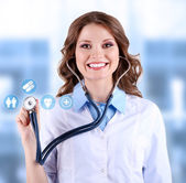 Female doctor with stethoscope and virtual screen — Stock Photo