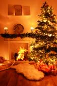 Christmas tree near fireplace in room — Stock Photo