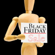 Wooden mannequin with Black Friday Sale advertising isolated on black — Stock Photo #60964395