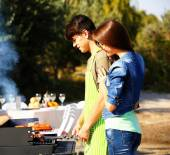 Beautiful couple having barbecue party, outdoors — Stock Photo