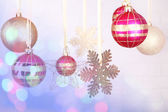 Christmas decorations hanging on festive background — Zdjęcie stockowe