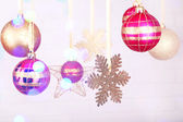Christmas decorations hanging on festive background — Foto de Stock