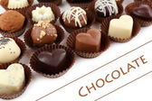 Delicious chocolate candies on white background — Stock Photo