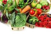 Fresh organic vegetables in wicker baskets, close up — Stock Photo