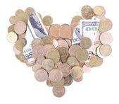 Heart shaped Ukrainian coins and dollars — Stock Photo