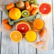 Fruits and vegetables and fresh juice — Stock Photo #61008597