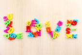 Love word formed with colorful letters on wooden table — Foto de Stock