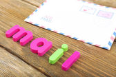 Mail word formed with colorful letters on wooden background — Stock Photo