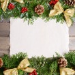 Christmas decoration with paper sheet on wooden background — Stock Photo #61015099