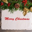 Christmas decoration with paper sheet on wooden background — Stockfoto #61015101