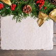 Christmas decoration with paper sheet on wooden background — Stockfoto #61015103