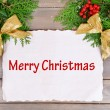 Christmas decoration with paper sheet on wooden background — Foto de Stock   #61015129