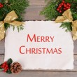 Christmas decoration with paper sheet on wooden background — Foto de Stock   #61015133