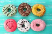 Delicious donuts with glaze — Stock Photo