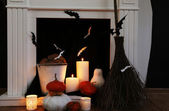 Halloween composition on fireplace closeup — Stock Photo