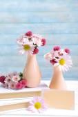 Beautiful flowers in vases — Stock Photo