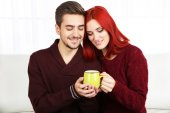 Couple with hot drink — Stock Photo