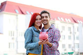Loving couple with piggy bank — Stock Photo