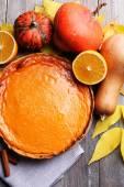 Homemade pumpkin pie on napkin, on wooden background — Stock Photo