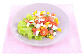 Appetizing fish salad with vegetables on plate isolated on white — Stock Photo