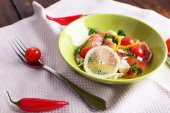 Appetizing fish salad with vegetables on plate on table close-up — Stock Photo