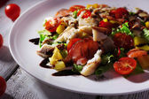Appetizing fish salad with vegetables on plate close-up  — Stock Photo