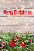 Beautiful Christmas border from fir and mistletoe on wooden background — Stockfoto