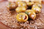 Green olives in oil — Stock Photo