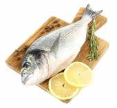 Fresh raw fish on cutting board and food ingredients isolated on white — Stok fotoğraf