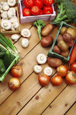Different vegetables in boxes — Stock Photo