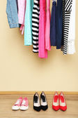 Colorful clothes and shoes — Stock Photo