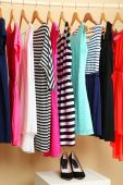 Female dresses on hangers — Stock Photo
