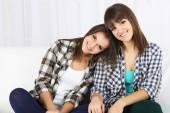 Beautiful girls twins at home — Stock Photo