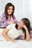 Beautiful girls twins in pajamas at home — Stock Photo