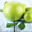 Ripe sweetie and limes on wooden background — Stock Photo #61045227