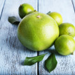 Ripe sweetie and limes on wooden background — Stock Photo #61045235