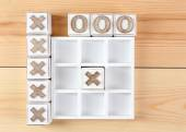 Game of Tic Tac Toe on wooden background — Stock Photo