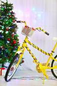 Bicycle near Christmas tree — Photo