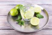 Lemonade in glass on tray — Stock Photo