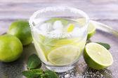 Lemonade in glass on tray — Stock Photo