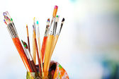Paint brushes with paints — Stock Photo