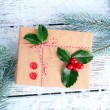 Cristmas gift with European Holly — Stock Photo #61058319
