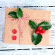 Cristmas gift with European Holly — Stock Photo #61058321