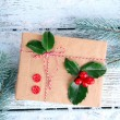 Cristmas gift with European Holly — Stock Photo #61058343