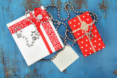 Gift boxes with card — Stock Photo
